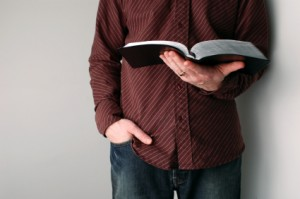 casual Christians guy with open bible