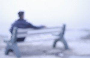 blurred man on a bench